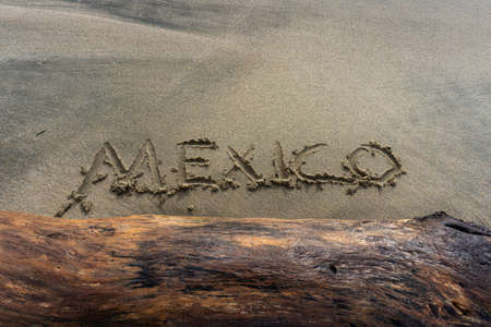 Mexico word Written in Mexican Beach Sand.