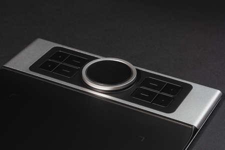 Round Dial Studio edit device with buttons on dark background. Zdjęcie Seryjne