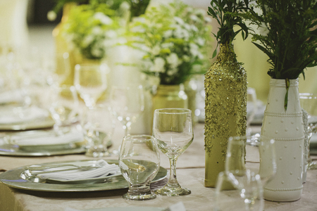 Table decorated for wedding event. Colors golden and white. Stock fotó