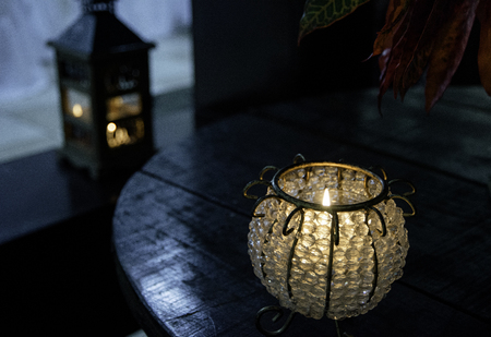 Candle lamp on wooden table. Decoration candle light. Stock Photo