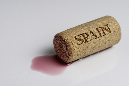 Wine cork isolated on the white. Recording the name of the Country Spain.