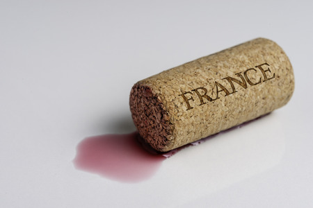 Wine cork isolated on the white. Record the name of the Country France.