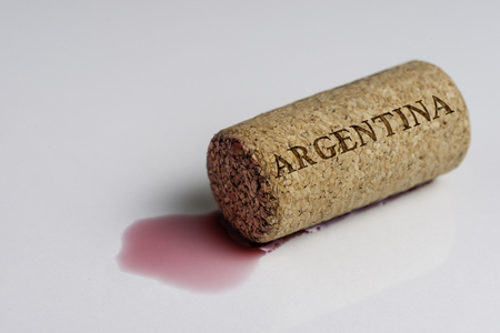 Wine cork isolated on the white. Recording the name of the Country Argentina.
