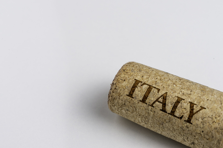 Wine cork isolated on the white. Recording the name of the Country Italy.