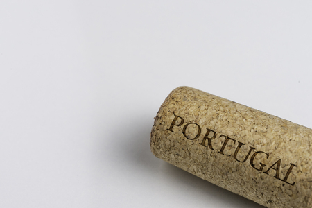 Wine cork isolated on the white. Recording the name of the Country Portugal. Фото со стока