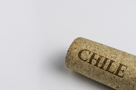 Wine cork isolated on the white. Record of the name of the Country Chile.