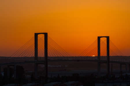 centenary: SEVILLE, SPAIN - AUGUST 21, 2017: Fifth Centenary Bridge with partial eclipse sunset Stock Photo