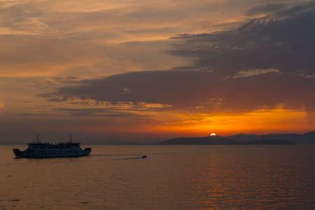 Dalmatian coast sunset from Jadrolinija ferry heading to Split Stock Photo - 89342368