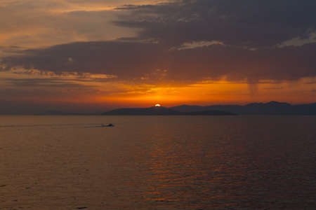 Dalmatian coast sunset from Jadrolinija ferry heading to Split Stock Photo - 89342369