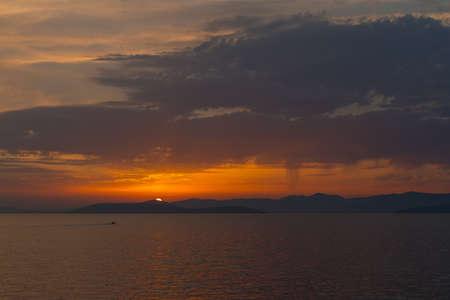 Dalmatian coast sunset from Jadrolinija ferry heading to Split Stock Photo - 88034807