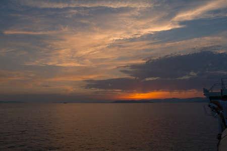 Dalmatian coast sunset from Jadrolinija ferry heading to Split Stock Photo - 88034814