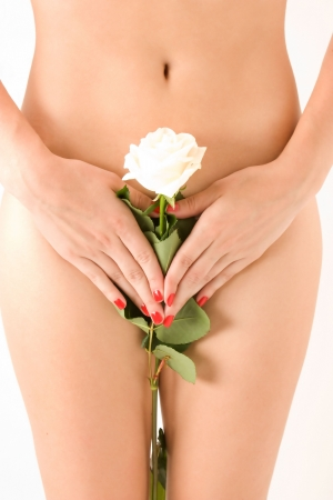 sexual girl: close up of a woman body with  white  rose on her pubes