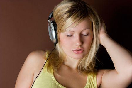 Beautiful women listening music in headphones Stock Photo - 5429839