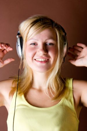 Pretty young girl listening music Stock Photo - 5444135