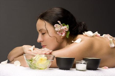 Beautiful woman on massage table with flower in hair Stock Photo - 5444128