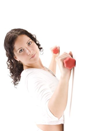 The woman with red dumbbells at a white wall photo