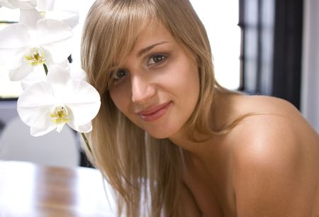 beautiful girl with white orchids photo