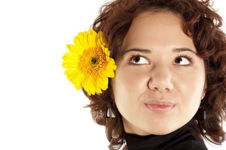 Portrait of the beautiful girl with a yellow flower photo