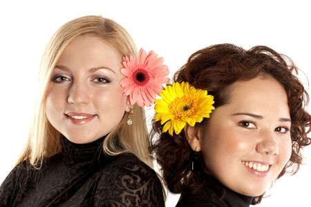 Portrait of two beautiful young girls with flowers in hair Stock Photo - 5938927