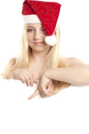 beautiful blonde in a cap of Santa Klaus photo