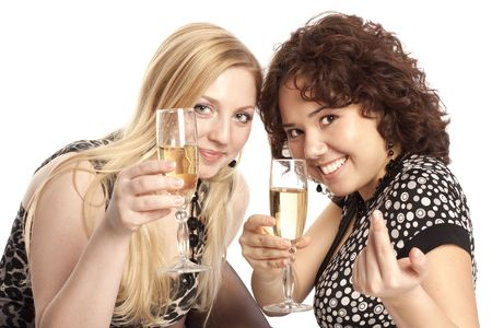 Beautiful smiling girls hold glasses with champagne photo
