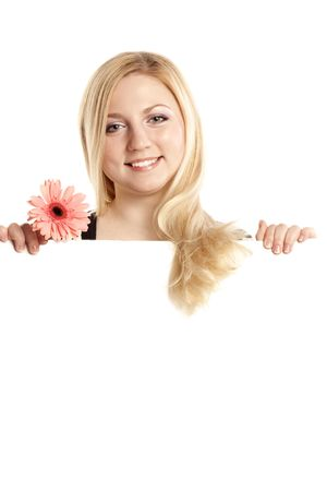 happy blonde with a pink flower holding a blank billboard photo