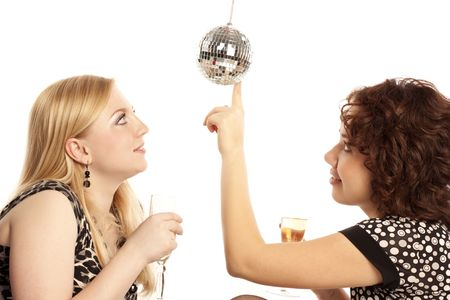 Two girlfriends with champagne meet Christmas photo