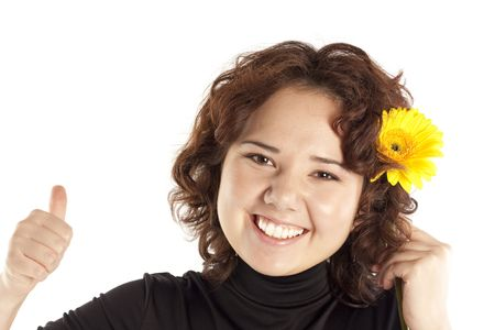 Portrait of the happy young girl with a yellow flower photo