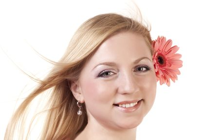 Portrait of the beautiful blonde with a pink flower photo