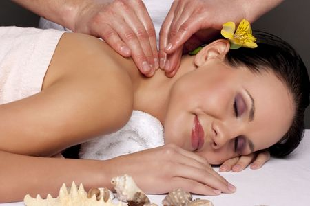 Close-up of a beautiful young woman getting a massage photo