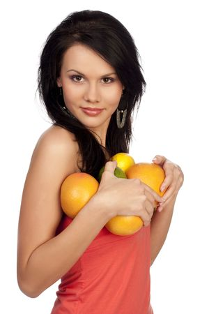 beautiful brunette with citrus on a white background photo