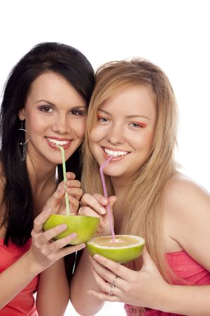 smiling girls drink juice from citrus through a straw photo