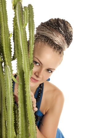 Portrait of the beautiful young woman with a green cactus on a white background photo