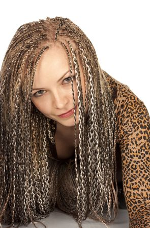 Portrait of the beautiful young woman with dreadlocks on a white background photo