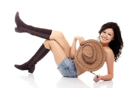 Beautiful brunette model with a cowboy hat over white background Stock Photo - 6244769