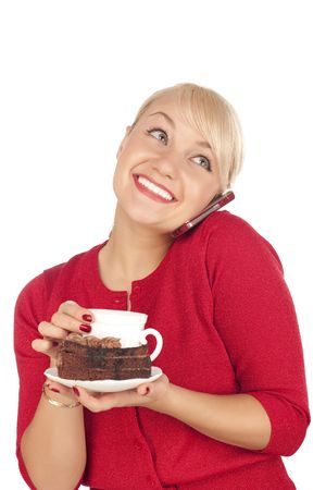 Smiling young blond woman holding a phone and cap of coffee. Isolated on a white background. Stock Photo - 6244826