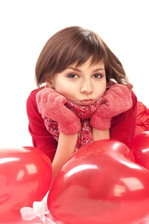 girl with red heart balloon on a white background photo