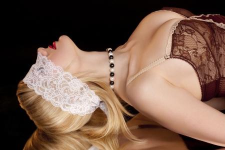 Beautiful woman with lace mask în a black background Stock Photo - 6271976