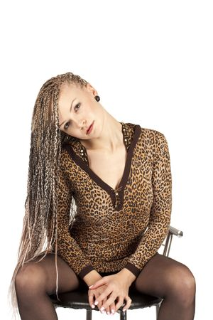 Portrait of the beautiful young woman with braids on a white background photo