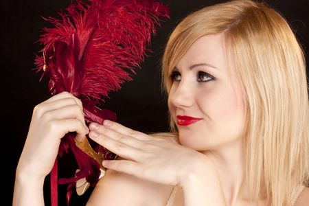 Portrait of the beautiful blonde with a red mask on a black background Stock Photo - 6271962
