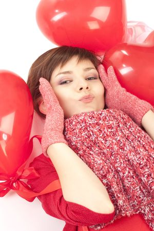 woman with red heart balloon on a white background photo