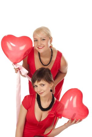 Two beautiful girls with red heart balloon over white photo