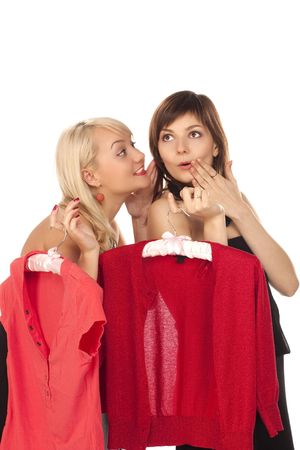 Two beautiful girlfriends on shopping over white photo