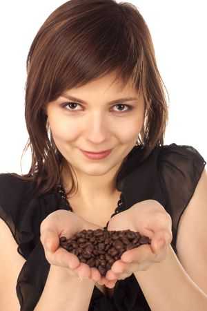 Attractive woman holding coffee beans.  Isolated on white. Stock Photo - 6289170