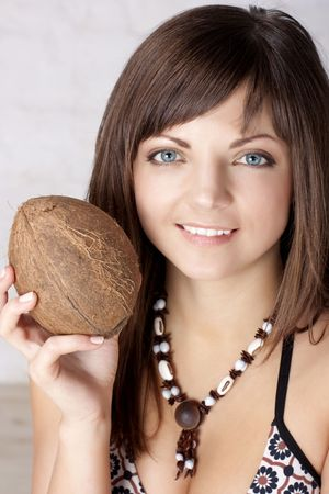 Portrait of the beautiful brunette with a coco Stock Photo - 6473154