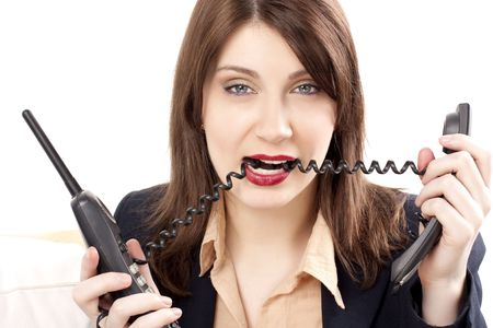 Beautiful businesswoman with two phones Stock Photo - 6473152