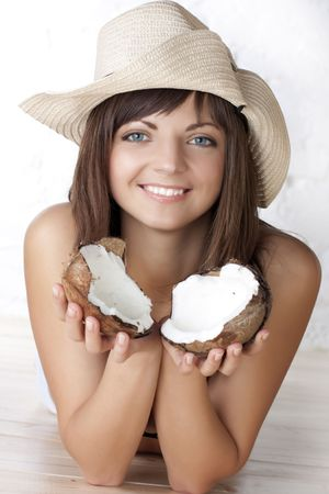 Portrait of the beautiful brunette with a coco photo