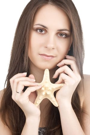 Young girl with starfish. Over white photo