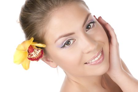 Portrait of a beautiful girl with a yellow orchid Stock Photo - 6632026