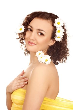 beautiful woman  with camomile flower on white background photo